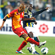 Fenerbahce's Moussa Sow (R) and Galatasaray's Felipe Melo De Carvalho (L) during their Turkish superleague soccer derby match Fenerbahce between Galatasaray at the Sukru Saracaoglu stadium in Istanbul Turkey on Sunday 12 May 2013. Photo by Aykut AKICI/TURKPIX