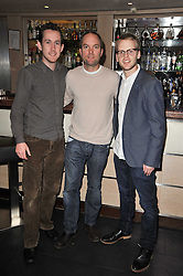 Left to right, CARBYN HILL, HUGO CHITTENDEN and JONNIE HORNER at a screening hosted by 'The Volunteer' of a documentary film of work in Haiti, held at the Courthouse Hilton Hotel, 19-21 Great Malborough Street, London on 29th March 2011.