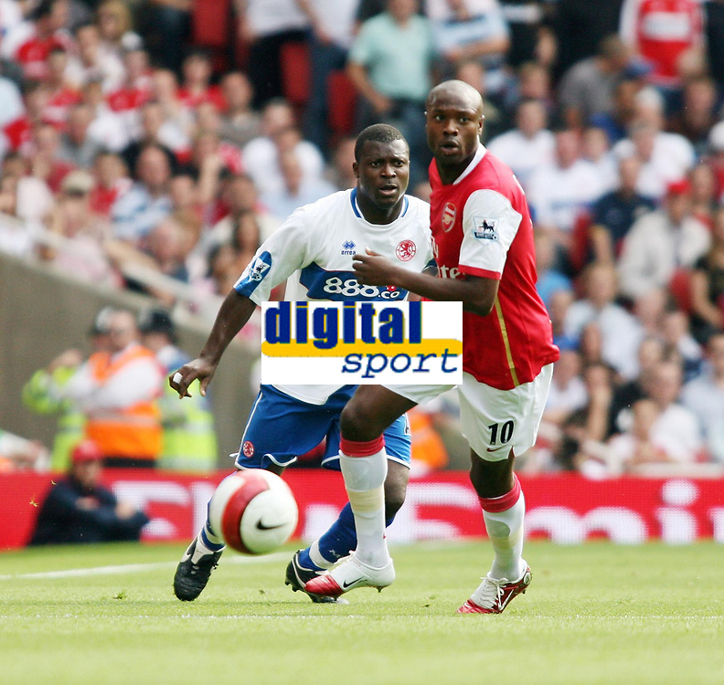 Photo: Chris Ratcliffe.<br />Arsenal v Middlesbrough. The Barclays Premiership. 09/09/2006.<br />William Gallas (R) of Arsenal and Yakubu of Boro.