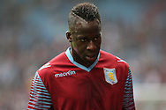 Aly Cissokho of Aston Villa leaves the field after pre-match warm up. Barclays Premier league match, Aston Villa v Arsenal at Villa Park in Birmingham on Saturday 20th Sept 2014<br /> pic by Mark Hawkins, Andrew Orchard sports photography.