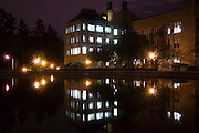Bagley Hall (Chemistry Building) is reflected at night in Drumheller Fountain on the University of Washington campus in Seattle, Washington on April 23, 2007.
