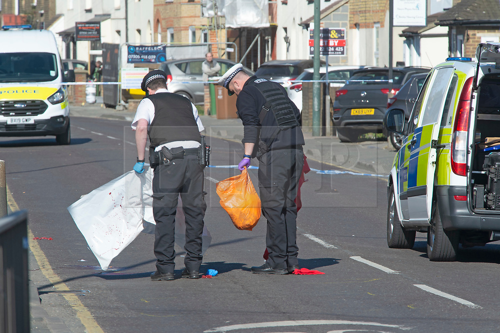 © Licensed to London News Pictures 09/03/2021. Bexley, UK. Police officers covering up blood in the road. A 65 year old cyclist has been killed after a collision with a van on Bourne Road in Bexley, South East London. Ambulance crews and police attended along with the Air Ambulance but the man died at the scene. The road is cordoned off by police while an investigation takes place. Photo credit:Grant Falvey/LNP
