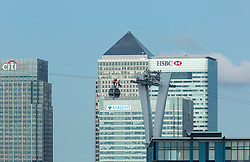 © Licensed to London News Pictures. 12/05/2012. .London, UK..Three cable car engineers working high in the London skyline, on the new, yet to be opened cable car services, will operate over the Thames between the Greenwich Peninsula and the Royal Docks. Photo credit : Andrew Baker/LNP
