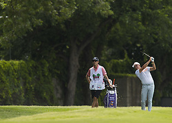 May 26, 2018 - Fort Worth, TX, USA - FORT WORTH, TX - MAY 26, 2018 - Rickie Fowler hits out of the rough after hitting a tree on his tee shot on the 15th hole during the third round of the 2018 Fort Worth Invitational PGA at Colonial Country Club in Fort Worth, Texas (Credit Image: © Erich Schlegel via ZUMA Wire)