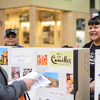 Tisha Boyd, from Camille's Sidewalk Cafe, hands out applications and talks with prospective employees at the job fair held at Rio West Mall in Gallup Friday.