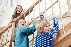 Three children at staircase