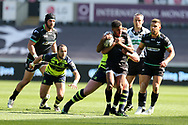 Keelan Giles of the Ospreys tries to break free from a tackle from Leinster's Tadhg Furlong. Guinness Pro12 rugby match, Ospreys v Leinster Rugby at the Liberty Stadium in Swansea, South Wales on Saturday 8th April 2017. <br /> pic by Andrew Orchard, Andrew Orchard sports photography.