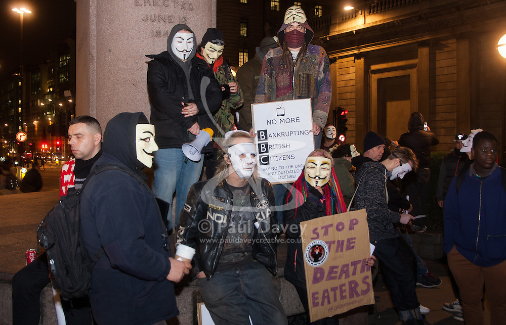 """London, December 23rd 2014. Online activism group Anonymous march through London from the City to the BBC's HQ on Great Portland Street in protest against alleged biases and coverups of a """"paedophile ring"""". PICTURED: Protesters observe six minutes' silence for the victims of the Glasgow dustcart accident which happened the previos day."""