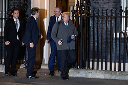 © Licensed to London News Pictures. 07/01/2019. London, UK. Former Foreign and Commonwealth Secretary Boris Johnson (right) leaving 10 Downing Street after attending a drinks reception in Number 10. British Prime Minister Theresa May is currently trying to persuade MPs to back her Brexit withdrawal deal. MPs will be debating the issue this week, with the postponed vote taking place on Tuesday 15th January. Photo credit : Tom Nicholson/LNP