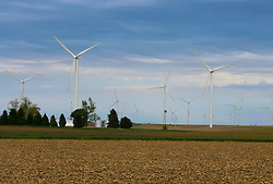 1 May 2010: Wind turbines dot the sky line at dusk under cloudy skies in the Twin Groves Wind mill farm east of Bloomington, near Moraine View State Park.