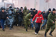 Moscow, Russia, 29/10/2008..Soldiers demonstrate crowd control tactics as colleagues play the role of football hooligans during Russian special forces training at a military base just outside Moscow. The exercise was part of the Interpolitex 2008 state security exhibition.