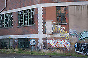 Street art adorns derelict at dilapidated factory buildings in the old industrial area and railway arches of Digbeth on 14th December 2020 in Birmingham, United Kingdom. Following the destruction of the Inner Ring Road, Digbeth is now considered a district within Birmingham City Centre, and is the epicentre for arts and graffiti artworks as well as its status as a once-gritty bohemian district known for street art and a young and hip people attending events and creative workshops at the Custard Factory and grungy clubs in former warehouses. As part of the Big City Plan, Digbeth is undergoing a large redevelopment scheme that will regenerate the old industrial buildings into apartments, retail premises, offices and arts facilities. There is still however much industrial activity in the south of the area.
