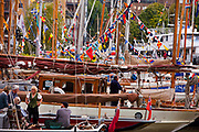 The Thames Festival is an autumn weekend celebration each September on the banks of the river Thames. St Katherine's Dock is crowded with classic sailing boats which come from all over the UK for a weekend of celebration