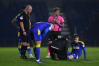 Football - 2020 / 2021 Sky Bet League One - AFC Wimbledon vs Peterborough United - Plough Lane<br /> <br /> AFC Wimbledon's Jack Rudoni receiving medical attention during the game.<br /> <br /> COLORSPORT/ASHLEY WESTERN