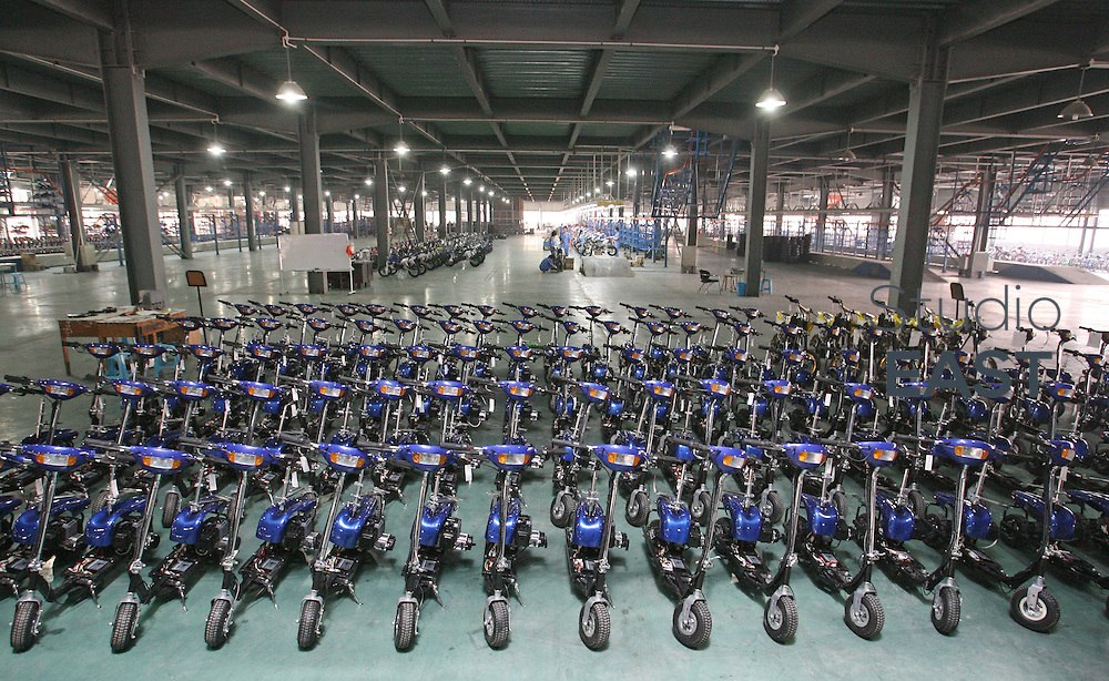ZHEJIANG PROVINCE, CHINA - September 17: YL 123 electric scooters wait to be exported to the USA in Easy vehicle factory on September 17, 2007 in Yong Kang, Zhejiang province, China. (Photo by Lucas Schifres/Getty Images)