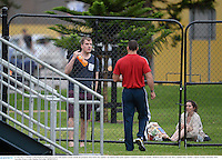 10 June 2013; A member of the British & Irish Lions security team speaks to locals outside the perimeter fence before the captain's run ahead of their game against Combined Country on Tuesday. British & Irish Lions Tour 2013, Captain's Run, Number 2 Sports Ground, Newcastle, NSW, Australia. Picture credit: Stephen McCarthy / SPORTSFILE