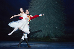 """© Licensed to London News Pictures. 10/12/2013. London, England. Picture: Shiori Kase as Clara and Yonah Acosta as The Prince. Final working stage rehearsal of """"Nutcracker"""" at the London Coliseum. Choreography by Wayne Ealing with music by Pyotr Ilyich Tchaikovsky. Photo credit: Bettina Strenske/LNP"""
