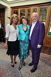 Left to right, LORNA PONTI, EDWINA CURRIE and CHRISTOPHER BIGGINS at 'Lunch for Life' in aid of Marie Curie Cancer Care held at Wentworth Golf Club, Berkshire on 2nd march 2009.