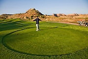 Bob Sorensen, an assistant golf course superintendent of The Golf Club at Redlands Mesa in Grand Junction, Colorado stands on the green during an early morning routine inspection of the golf course. (Bob Sorensen is featured in the book What I Eat: Around the World in 80 Diets.) He played football at Mesa State College in Grand Junction and graduated with a degree in criminal justice. Just before he took a desk job in his chosen profession he decided that he didn't want a desk job and found one that requires his constant attendance of the great outdoors, at a golf course at the foot of the majestic Colorado National Monument.  He earned a second degree in turf management, supervises a small crew of greenskeepers, and coaches high school football at Palisade High School.