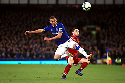 Everton's Richarlison (left) and Liverpool's Andrew Robertson battle for the ball during the Premier League match at Goodison Park, Liverpool.