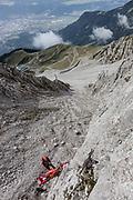 "Innsbruck, rescue operation with the team at Innsbrucker Klettersteig (via ferrata) in the rocks of the ""Nordkette"""