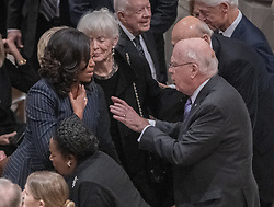 former first lady Michelle Obama and United States Senator Patrick Leahy (Democrat of Vermont) converse prior to the National funeral service in honor of the late former US President George H.W. Bush at the Washington National Cathedral in Washington, DC on Wednesday, December 5, 2018.<br /> Photo by Ron Sachs / CNP/ABACAPRESS.COM