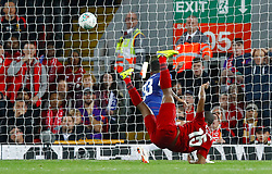 Liverpool's Daniel Sturridge scores his side's first goal of the game during the Carabao Cup, Third Round match at Anfield, Liverpool.
