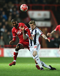 Mark Little of Bristol City challenges for the aerial ball with James McClean of West Bromwich Albion - Mandatory byline: Dougie Allward/JMP - 19/01/2016 - FOOTBALL - Ashton Gate - Bristol, England - Bristol City v West Brom - FA Cup Third Round