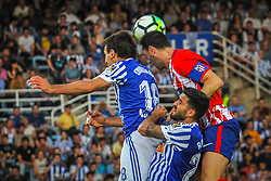 April 19, 2018 - San Sebastian, Spain - Godin of Atletico Madrid duels for the ball with Oyarzabal and Raul Navas of Real Sociedad during the Spanish league football match between Real Sociedad and Atletico Madrid at the Anoeta Stadium on 19 April 2018 in San Sebastian, Spain  (Credit Image: © Jose Ignacio Unanue/NurPhoto via ZUMA Press)