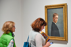 """© Licensed to London News Pictures. 27/06/2019. LONDON, UK. Visitors view """"Self-portrait at the Age of Twenty (Autoportrait à l'âge de vingt ans)"""", 1885, by Félix Vallotton. Preview of """"Félix Vallotton:  Painter of Disquiet"""", an exhibition of paintings and prints Swiss artist Félix Vallotton at the Royal Academy of Arts.  Around 100 works are on show 30 June to 29 September 2019.   Photo credit: Stephen Chung/LNP"""