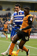 Bakary Sakho battles for possession with Stephen Kelly during the Sky Bet Championship match between Wolverhampton Wanderers and Reading at Molineux, Wolverhampton, England on 7 February 2015. Photo by Alan Franklin.
