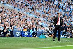 Manchester United Manager, David Moyes cuts a dejected figure as Manchester City score - Photo mandatory by-line: Dougie Allward/JMP - Tel: Mobile: 07966 386802 22/09/2013 - SPORT - FOOTBALL - City of Manchester Stadium - Manchester - Manchester City V Manchester United - Barclays Premier League