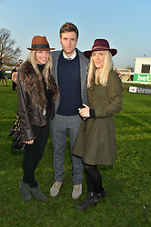 Left to right, JESS LORD, TV presenter GREG JAMES and CARLY MOSS at the 2014 Hennessy Gold Cup at Newbury Racecourse, Newbury, Berkshire on 29th November 2014.  The Gold Cup was won by Many Clouds ridden by Leighton Aspell.