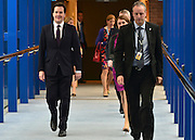 © Licensed to London News Pictures. 08/10/2012. Birmingham, UK Chancellor of the Exchequer George Osborne walks to the conference room on the day of his keynote conference speech at The Conservative Party Conference at the ICC today 8th October 2012. Photo credit : Stephen Simpson/LNP