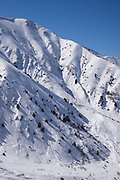 The top of Chimgan's chairlift is the Grand Chimgan, peaking at 3309m. Chimgan ski resort on 28th February 2014 in Uzbekistan. Chimgan is 90kms east of the capital Tashkent, and a popular weekend destination year round.