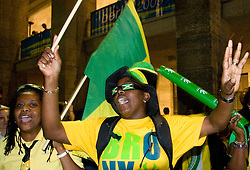 Fans of Jamaica celebrate win of Usain Bolt at 100m men  at the 2009 IAAF Athletics World Championships on August 16, 2009 in Berlin, Germany. (Photo by Vid Ponikvar / Sportida)