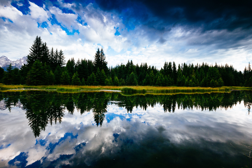 An autumn reflection during rainy weather in the Tetons near Jackson, Wyoming.