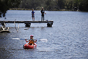 9 year old child in kayak on Swan River, Bassendean, Perth, Western Australia