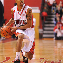 Feb 22, 2009; Piscataway, NJ, USA; Rutgers guard Mike Rosario (3) passes to teammate forward Gregory Echenique (not pictured) during the first half of Rutgers' 74-56 loss to West Virginia at the Louis Brown Athletic Center.