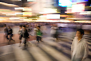 people walking on the zebra crossing in Shibuya