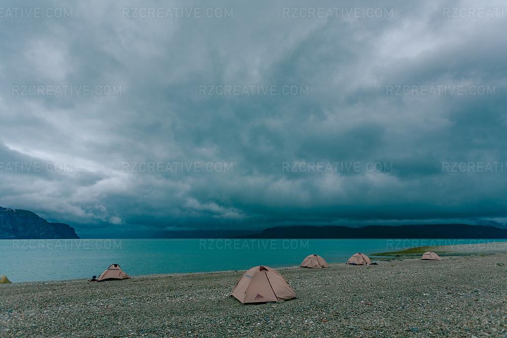 Tents line the rocky beach at Ptarmigan Creek in southeast Alaska's Glacier Bay National Park.
