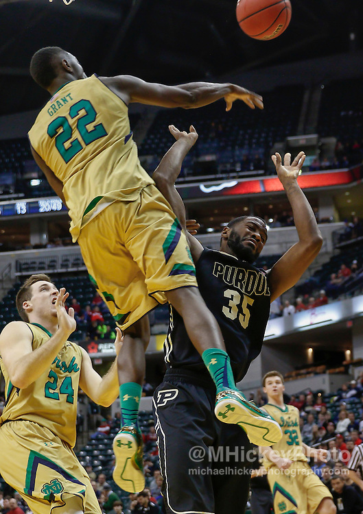 INDIANAPOLIS, IN - DECEMBER  20: Jerian Grant #22 of the Notre Dame Fighting Irish swipes the ball on Rapheal Davis #35 of the Purdue Boilermakers at Bankers Life Fieldhouse on December 20, 2014 in Indianapolis, Indiana. Notre Dame defeated Purdue 94-63. (Photo by Michael Hickey/Getty Images) *** Local Caption *** Jerian Grant; Rapheal Davis