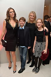 Left to right, ELIZABETH HURLEY, her son DAMIAN HURLEY, NADJA SWAROVSKI and her daughter at a pre party for the English National Ballet's Christmas performance of The Nutcracker was held at the St.Martin's Lane Hotel, St.Martin's Lane, London on 12th December 2013.