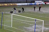 Newport AFC ground staff work on the Rodney Parade pitch after a downpour of heavy rain an hour and half before k/o. EFL Skybet football league two match, Newport county v Crawley Town at Rodney Parade in Newport, South Wales on Saturday 1st April 2017.<br /> pic by Andrew Orchard, Andrew Orchard sports photography.