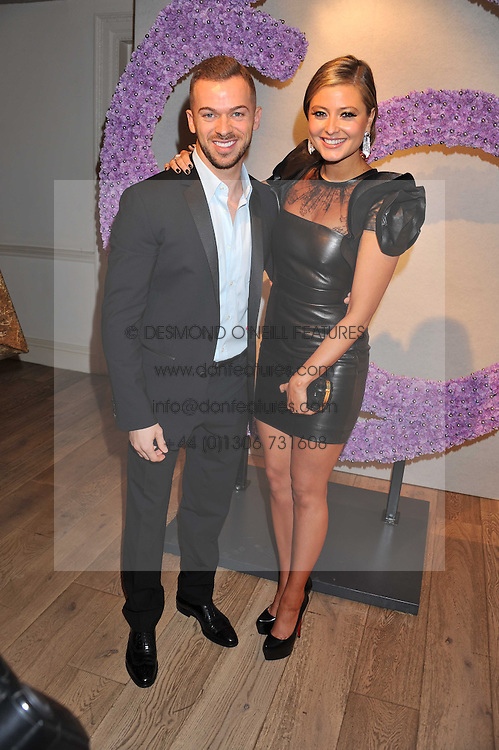 ARTEM CHIGVINTSEV and, HOLLLY VALANCE at a reception to celebrate the publication of Candy and Candy: The Art of Design held at the Halcyon Gallery, 24 Bruton Street, London W1 on 26th October 2011.