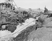 """9305-B7385-11. Young boys fishing in Downes channel. """"Views of Celilo Falls before dam closure. October 5, 1956"""""""