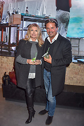 Tina Hobley and Oliver Wheeler at a VIP private view of 21st Century Women held at Unit London, Hanover Square, London England. 03 October 2018.