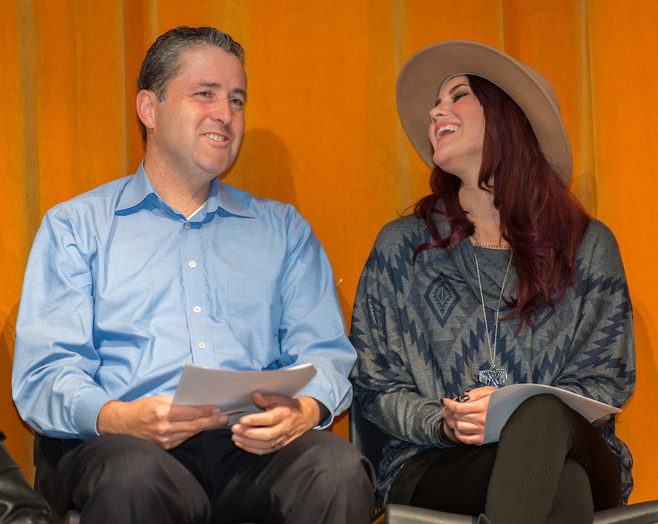 """University of Houston professor Dr. Arturo Hernandez, left, and telenovela actress Dulce Maria, right, during a Televisa Foundation """"Live the Dream"""" event at Burbank Middle School, December 9, 2013."""