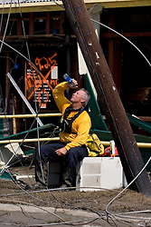 26th Sept, 2005.  Cameron, Louisiana.  Hurricane Rita aftermath. <br /> Members of the Las Vegas, Nevada Task Force 1, a FEMA search and rescue team scour the destroyed remains of houses and business in Cameron, Louisiana for any signs of life two days after the storm ravaged the small town. Harold Wyatt takes a water cooling break in the baking heat.<br /> Photo; ©Charlie Varley/varleypix.com