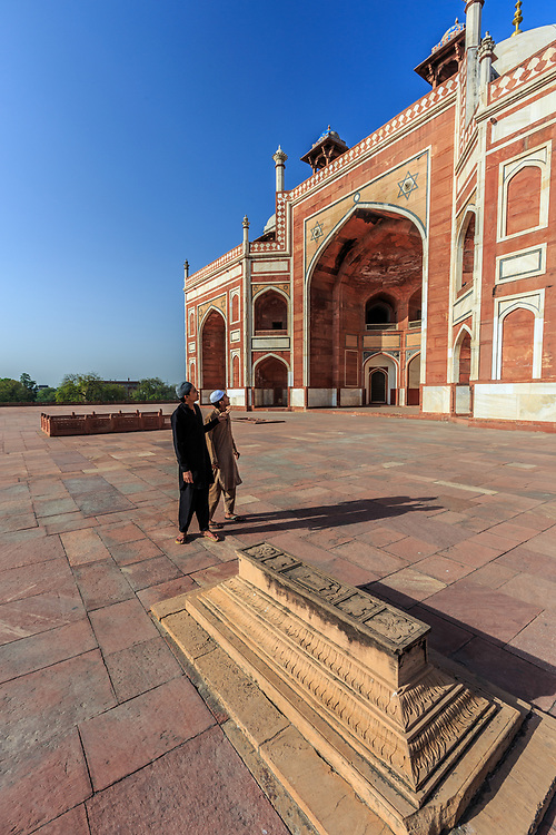 Admiring visitors at Humayun's Tomb in New Delhi, India. Several Mughal emperors are buried inside Humayun's mausoleum. No sepulcher in India or elsewhere contains such a high number of tombs of the Mughal emperors and their relatives.